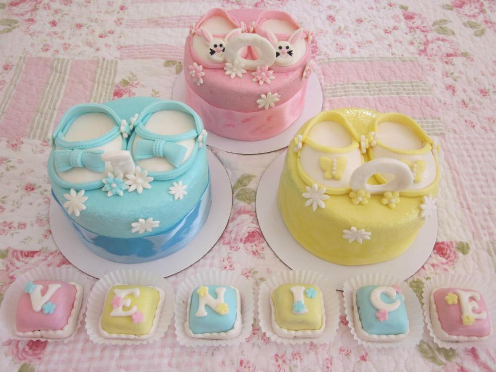 mini cakes with a pair of fondant shoe toppers and petit fours