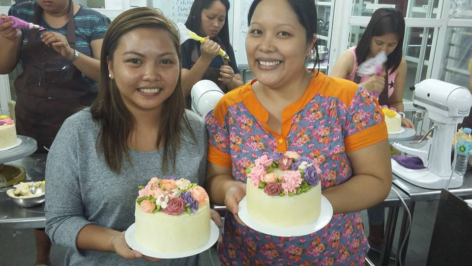 Me (in orange blouse) with a classmate in Sorelle Floral Cake's class in Ongkinking Cebu last May 24 (which also happened to be my birthday. Attending her class was my birthday gift to myself.) Photo from Sorelle Floral Cakes' page.
