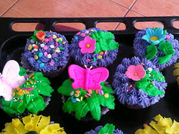 These were the first cupcakes I decorated with the help of my friend Ristie. (June 11, 2011)